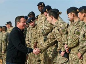 File photo of UK PM David Cameron with British troops. AP