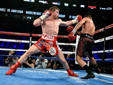 Canelo Alvarez aims a punch at Amir Khan during the WBC middleweight title fight in Las Vegas. Getty Images