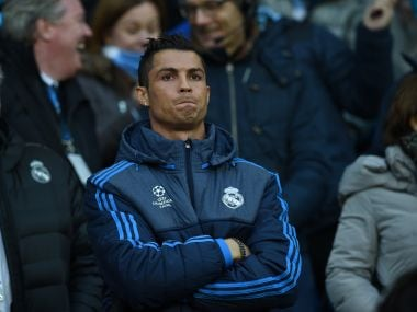 Real Madrid's Cristiano Ronaldo stands in the crowd as a spectator during the first leg. AFP