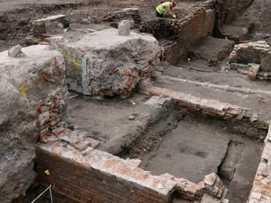 An archaeologist works on the exposed remains as the site of Shakespeare's Curtain Theatre is excavated in Shoreditch in London, on Tuesday. AP