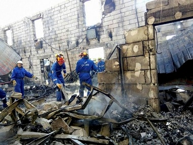 Ukrainian Emergency Situations Ministry Press Service, emergency ministry employees search a site of a fire at Litchi, Kiev region, Ukraine. Ukraine's emergency services say a fire has swept through a private home for the aged, killing over a dozen of the 35 residents and injuring five others. No cause has yet been determined for the fire that broke out early Sunday in Litochki, a village 42 kilometers (25 miles) north of Kiev, the capital. AP/PTI(AP5_29_2016_000126B)