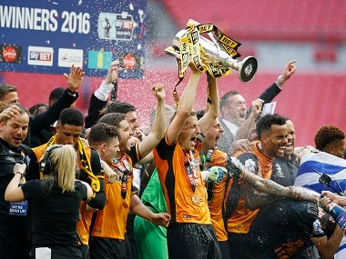 Hull City players celebrate their side's return to the Premier League. Reuters