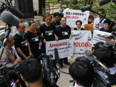Survivors of the atomic bomb and their supporters hold a press conference at the monument of the Korean victims of the bombing in Hiroshima Peace Memorial Park on Friday. AP