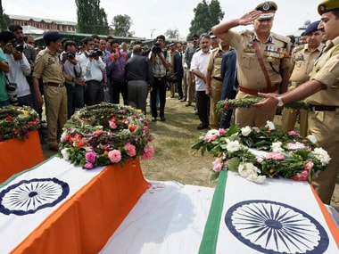 Director General of Jammu and Kashmir police K Rajindra Kumar paying tributes to the three policemen who were shot dead by militants in twin strikes in the summer capital Srinagar on Monday. PTI
