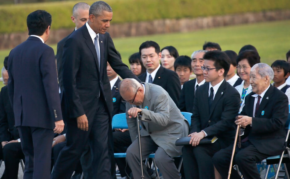 Obama, left, and Japanese Prime Minister Shinzo Abe, second from right, greet Shigeaki Mori, second from left, created memorial for American WWII POWs killed at Hiroshima, and Sunao Tsuboi, chairman of Japan Confederation of A-and H-Bomb Sufferers Organizations, each other during the event. AP