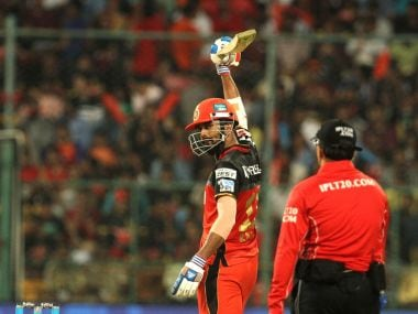 Royal Challengers Bangalore player KL Rahul raises his bat after scoring a fifty. BCCI