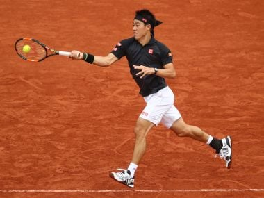 Kei Nishikori of Japan hits a forehand in action at the French Open. Getty