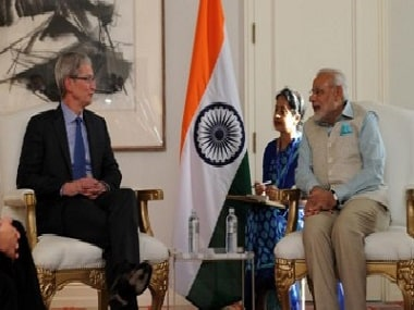 Apple CEO Tim Cook and Prime Minister Narendra Modi. PTI