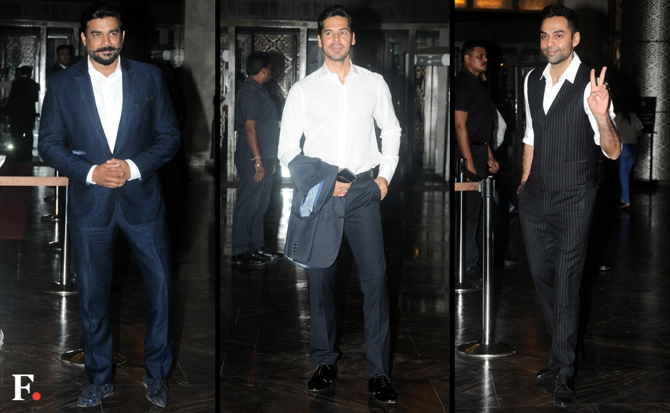 R. Madhavan, Dino Morea, Abhay Deol (L to R) attend Priety's reception. Firstpost/Sachin Gokhale