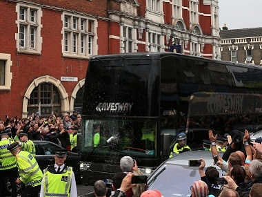 A drink can hits the Manchester United team bus. AP