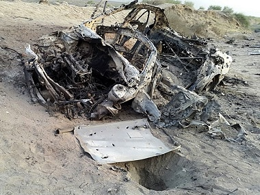 The destroyed vehicle in which  Mullah Mohammad Akhtar Mansour was traveling in the Ahmad Wal area in Baluchistan province of Pakistan. AP