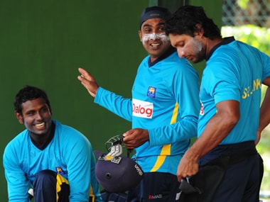 File photo of Mahela Jayawardene with captain Angelo Mathews and Kumar Sangakkara. AFP