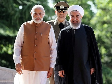 Prime Minister Narendra Modi and Iran's President Hassan Rouhani (R) in Tehran. and review the honor guard during an official welcoming ceremony in Tehran, Iran May 23, 2016. President.ir/Handout via Reuters