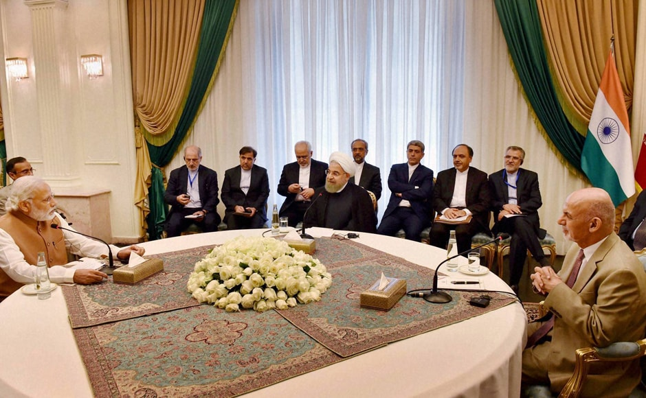 PM Narendra Modi with Iranian President Hassan Rouhani and President of Afghanistan Ashraf Ghani during Trilateral meeting at Talar building, Saadabad Palace in Tehran. PTI