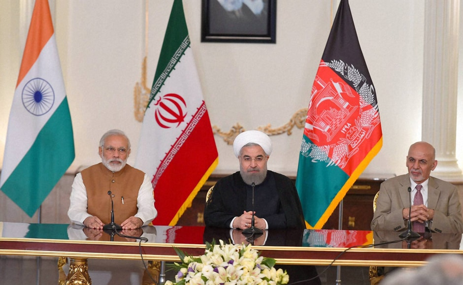 PM Narender Modi with Iranian President Hassan Rouhani and Ashraf Ghani, President of Afghanistan during agreement signing and press statement after Trilateral meeting at Talar building; Saadabad Palace in Tehran. PTI