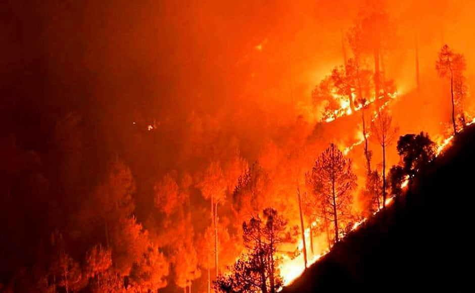 A major fire in the forests at Ahirikot in Srinagar, Uttarakhand on Monday. PTI