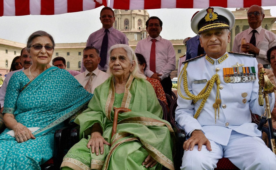 Admiral Sunil Lanba with his family before taking charge as the new Indian Navy chief at South block in New Delhi on Tuesday. PTI