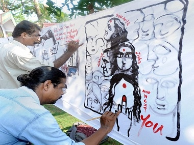 Artists in Kannur paint posters at a protest demanding justice for Jisha. PTI.