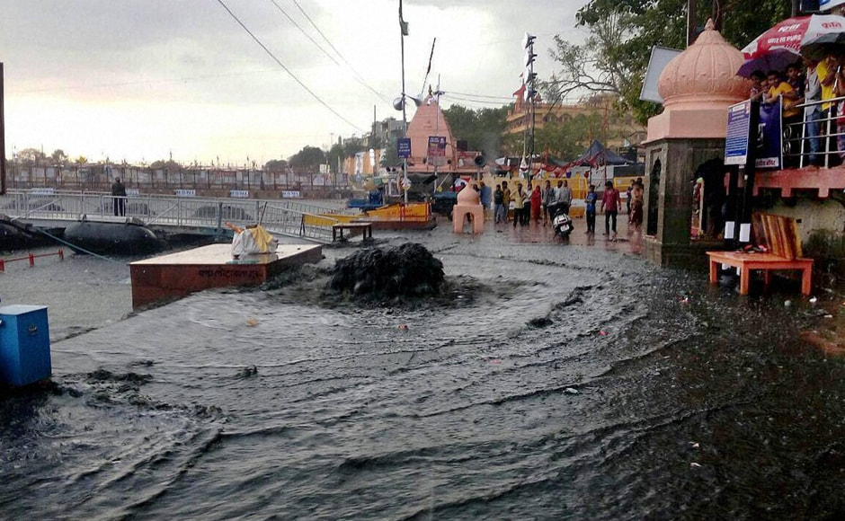 A heavy thunderstorm at the Simhastha Mahakumbh in Ujjain. PTI