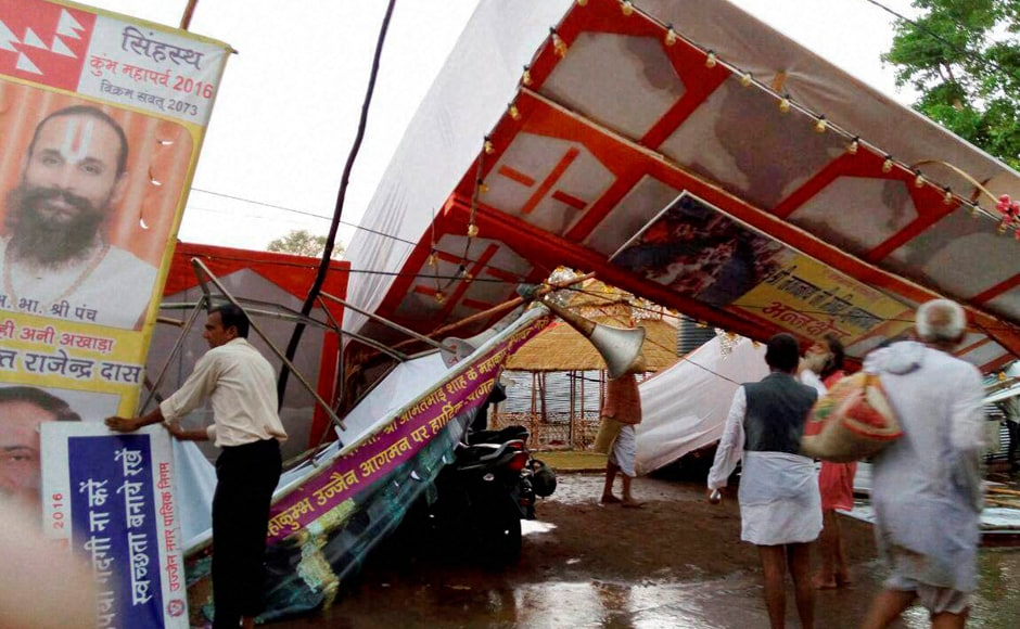 A pandal collapses due to heavy storm during Simhastha Mahakumbh in Ujjain. PTI