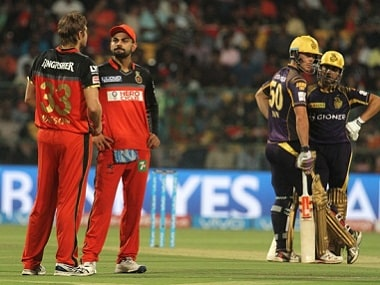 RCB captain Virat Kohli speaks with teammate Shane Watson during their match against KKR. BCCI