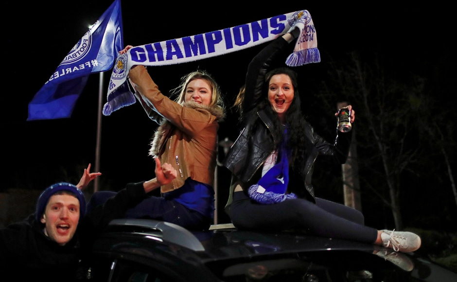 Leicester City fans celebrate outside the King Power stadium after their team won the Premier League title. Reuters
