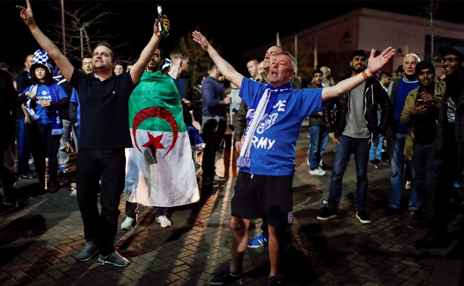 Leicester City fans celebrate outside the King Power stadium after their team won the Premier League title in Leicester. Reuters