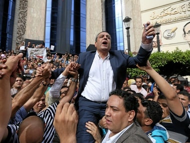 Journalists carry Yehia Kalash, head of the Egyptian press syndicate. File photo. Reuters