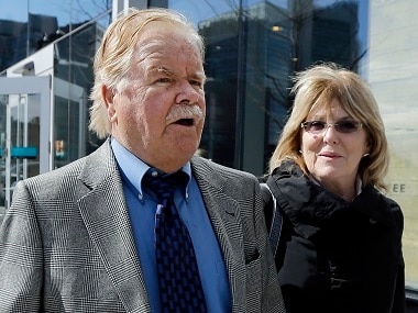 Robert Fitzpatrick walks from federal court in Boston with his wife Jane. AP