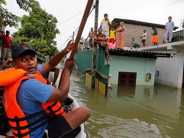 Relief workers distribute aid to flood victims in Wellampitiya, on the outskirts of Colombo. AP