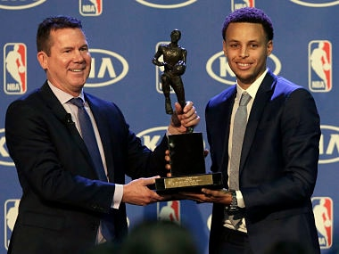 Stephen Curry, right, being presented with the NBA's Most Valuable Player award. AP