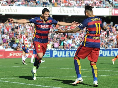 Luis Suarez (L) of Barcelona celebrates scoring his hat-trick against Granada. Getty