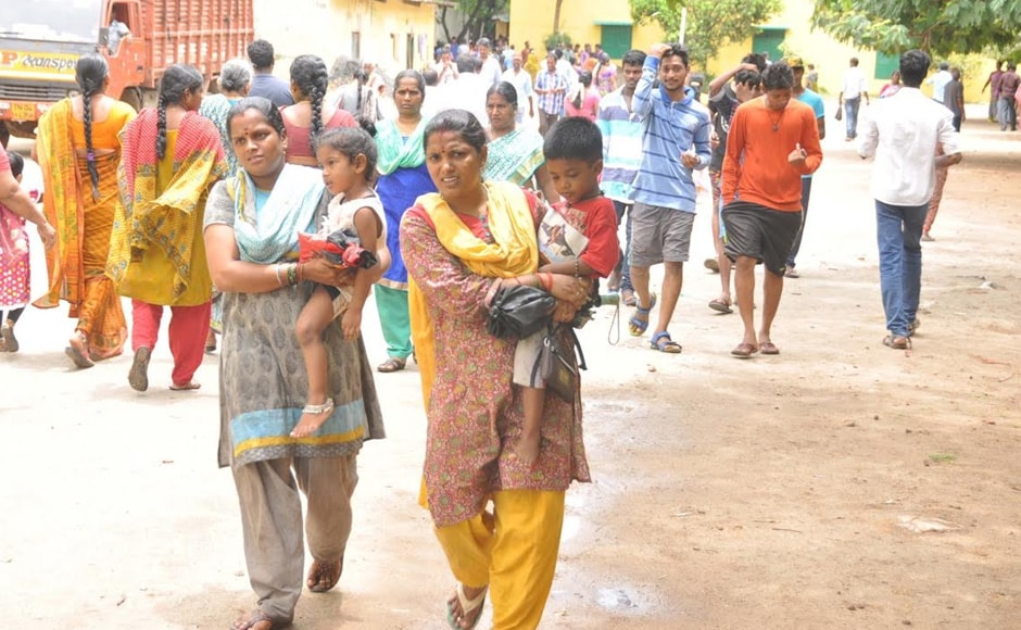 People arrive at a polling booth in Tamil Nadu on Monday. Voters in Tamil Nadu, Kerala and Puducherry cast their ballot on Monday. Firstpost/ Vanne Srinivasalu