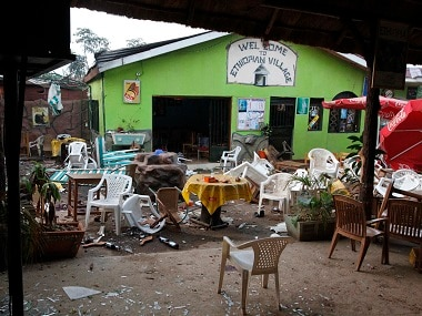 """Damaged chairs and tables lie amongst the debris strewn after a bomb attack outside the """"Ethiopian Village"""" restaurant in Kampala. File photo AP"""