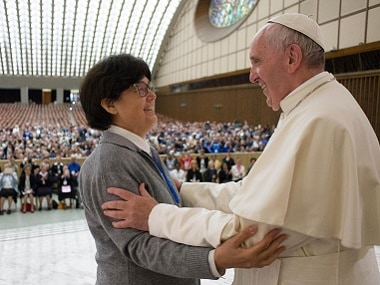 Pope Francis hugs Sister Carmen Sammut, a Missionary Sister of Our Lady of Africa at the end of a special audience with members of the International Union of Superiors General in the Paul VI Hall at the Vatican on Thursday. L'Osservatore Romano/Pool photo via AP