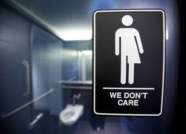 A sign protesting restrictions on transgenders to enter bathrooms. Reuters