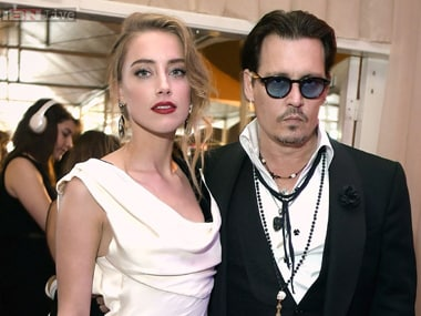Amber Heard with Johnny Depp. File photo