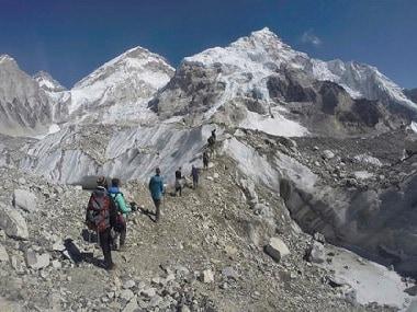 International trekkers pass through a glacier at the Mount Everest base camp, Nepal. AP