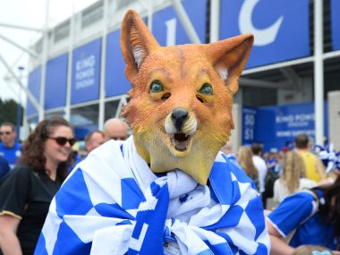 A Leicester City supporter wearing a fox mask, arrives at the stadium ahead of the English Premier League football match between Leicester City and Everton. AFP