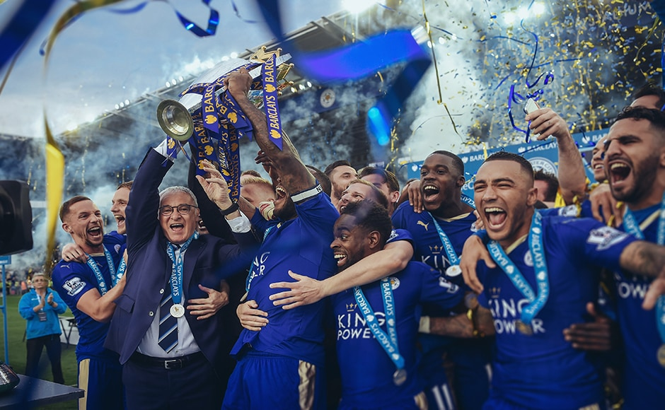 Captain Wes Morgan and manager Claudio Ranieri of Leicester City lift the Premier League Trophy. Getty