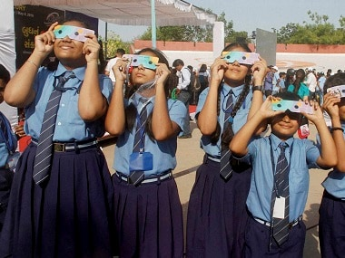 School students watch transit of Mercury through dark films at the science city in Ahmedabad on Monday. PTI