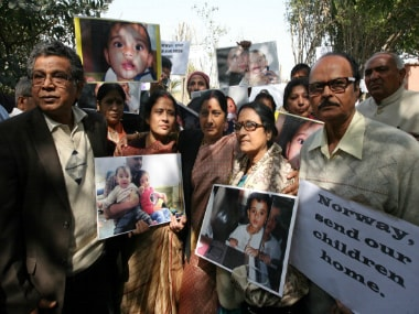 Sushma Swaraj protest with grandparents of NRI children Aishwarya and Abhigyan during a protest demanding their return from Norway, outside the Norwegian Embassy in New Delhi. Getty Images