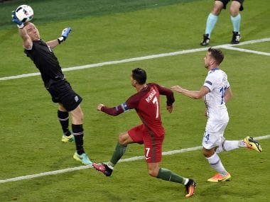 Iceland's goalkeeper Hannes Thor Halldorsson jumps for the ball as Portugal's forward Cristiano Ronaldo. AFP