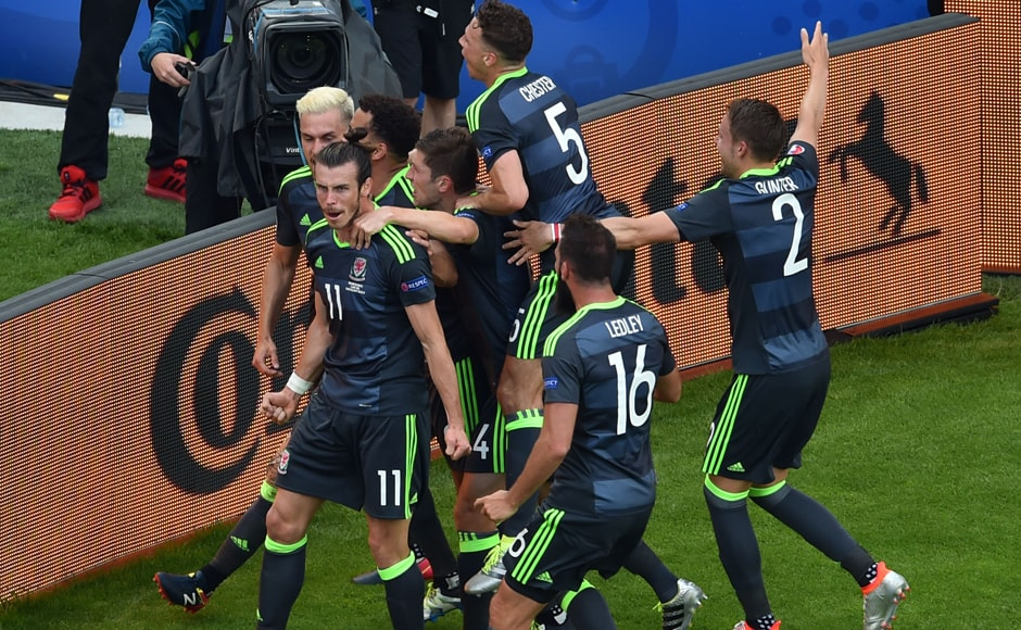 Wales' forward Gareth Bale celebrates with teammates after scoring his team's first goal during the Euro 2016 group B match.