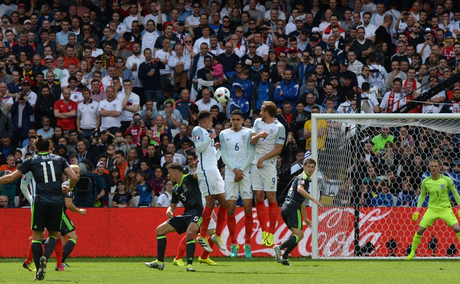 Wales' forward Gareth Bale shoots to score his team's first goal during the Euro 2016 group B football match. AFP