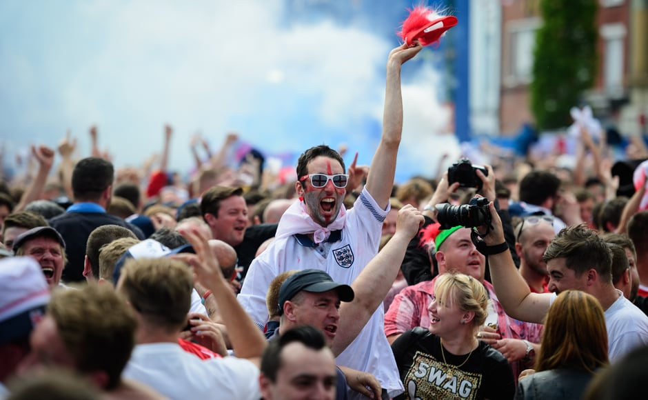 England fans celebrate in the fanzone in Lens, northern France after England scored their first goal against Wales in the Euro 2016. AFP