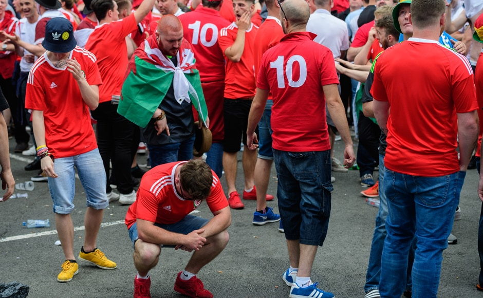 Dejected Wales supporters show their feelings in the fanzone in central Lens as England beat Wales 2-1. AFP