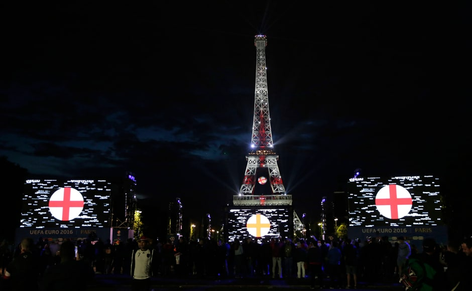 The Eiffel Tower is lit with the colors of England's flag, as seen from the fan zone after the showing of the Euro 2016 group C match between Germany and Poland. AFP