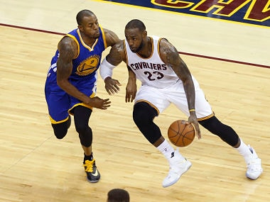 LeBron James duels with Andre Iguodala. AFP