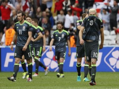 Aaron Ramsey and Wales players react at the end of the loss against England. Reuters